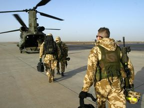 British soldiers board a transport helicopter in the southern Iraqi city of Basra 29 January 2005