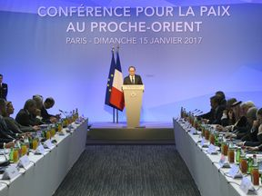 French President Francois Hollande addresses the conference