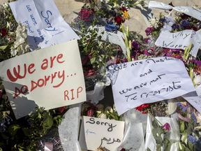 Messages and flowers placed at the scene of the attack in Sousse