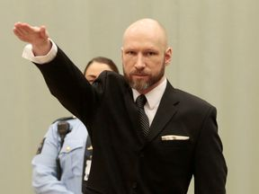 Anders Breivik gives a Nazi salute at the start of the court hearing