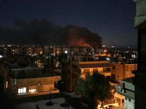 Smoke is seen rising from Mezzah airport. Pic: Chahed News