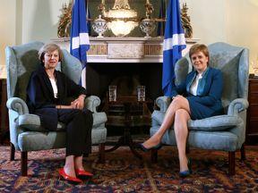 Nicola Sturgeon and Theresa May in July