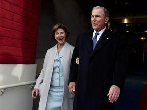 Former U.S. President George W. Bush and First Lady Laura Bush arrive