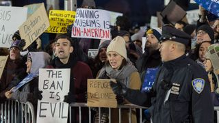 Protesters gathered at New York's JFK Airport in anger at the executive order