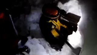 Rescue workers dig through snow to reach guests trapped in an Italian hotel buried by an avalanche.