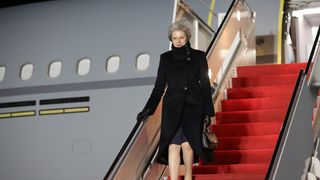 British Prime Minster Theresa May exits her plane on January 26, 2017 at Joint Base Andrews, Maryland. British Prime Minister Theresa May is on a two-day visit to the United States and will be the first world leader to meet with President Donald Trump