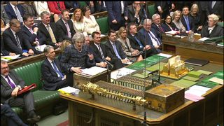 Theresa May answers MPs' questions in the Commons