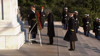 Theresa May lays a wreath at Arlington Cemetery in the US