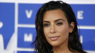 Kim Kardashian West was tied up and robbed at gunpoint in her Paris apartment in October
