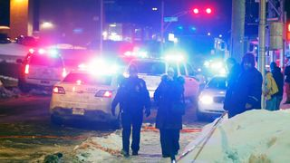Police officers are seen near a mosque after a shooting in Quebec City, January 29, 2017. REUTERS/Mathieu Belanger
