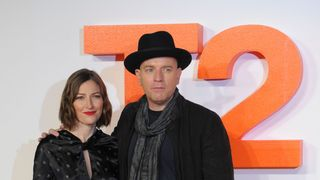 British actor Ewan McGregor poses with British actress Kelly Macdonald on the red carpet arriving to attend the world premiere of the film T2 Trainspotting in Edinburgh.