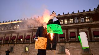 People burn effigies of US President-elect Donald Trump (L) and Mexican President Enrique Pena Nieto