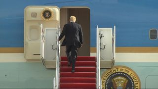 President Trump climbs on board Air Force One for the first time as Commander in Chief