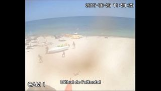 CCTV of people running away from Sousse attacker
