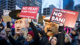 Protestors hold up signs in front of effigies of U.S. President Donald Trump and Russian President Vladimir Putin during in a demonstration on January 29, 2017 in Seattle, Washington, against Trump's executive order banning Muslims from certain countries. The rally was one of several in the area over the weekend
