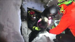 Children are plucked to safety from under tonnes of snow and debris