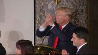 Donald Trump applauds the Clintons at Congressional luncheon