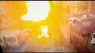 A blast engulfs a street in Izmir