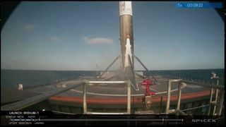 Part of the rocket lands on a base in the sea