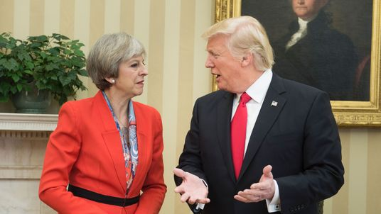 British Prime Minister Theresa May (L) and US President Donald speak in the Oval Office of the White House on January 27, 2017 in Washington, DC