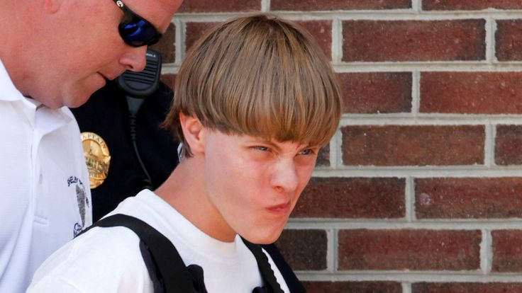 Police lead suspected shooter Dylann Roof, 21, into the courthouse in Shelby, North Carolina, June 18, 2015