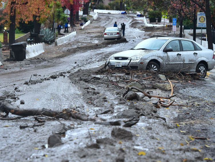 Mud and debris covers a residential road in Duarte, California