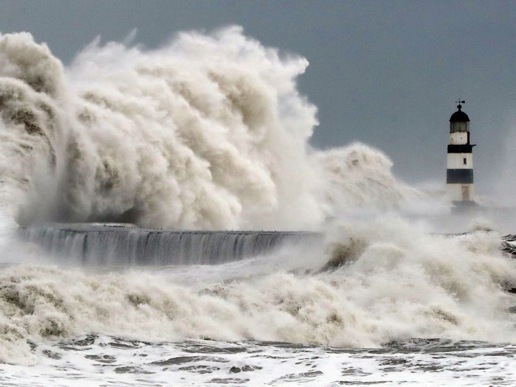 Waves crashing at the sea wall at Seaham Harbour in County Durham