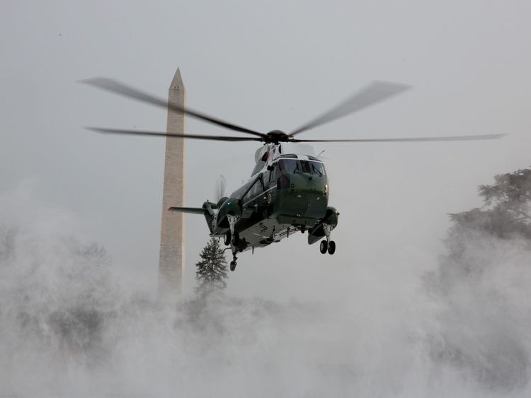 Snow is blown up by the landing of Marine One prior to the departure of U.S. President Barack Obama January 7, 2017 at the White House in Washington, DC