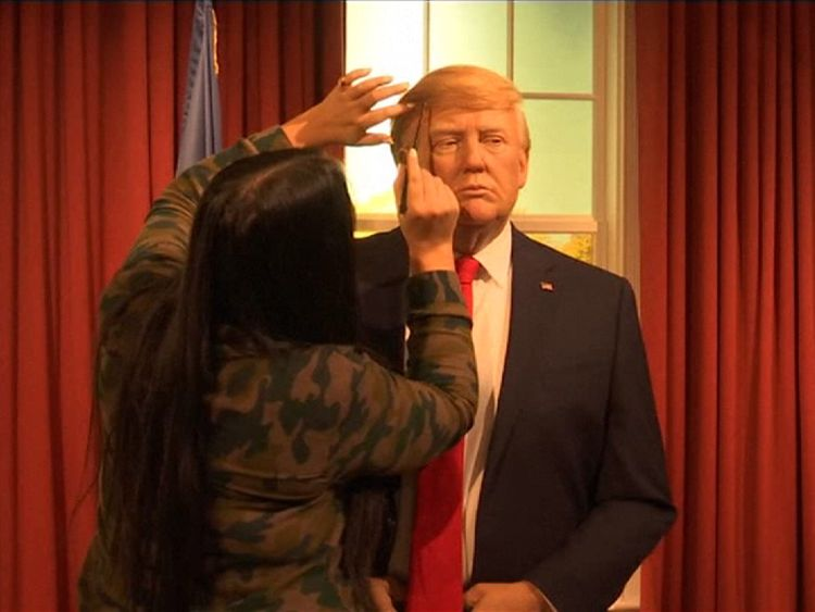 A Madame Tussauds' artist touches up a new waxwork of Donald Trump in New York