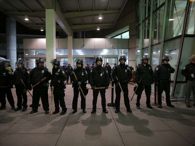 Police block an entrance as protesters gather at Terminal 4 of JFK Airport