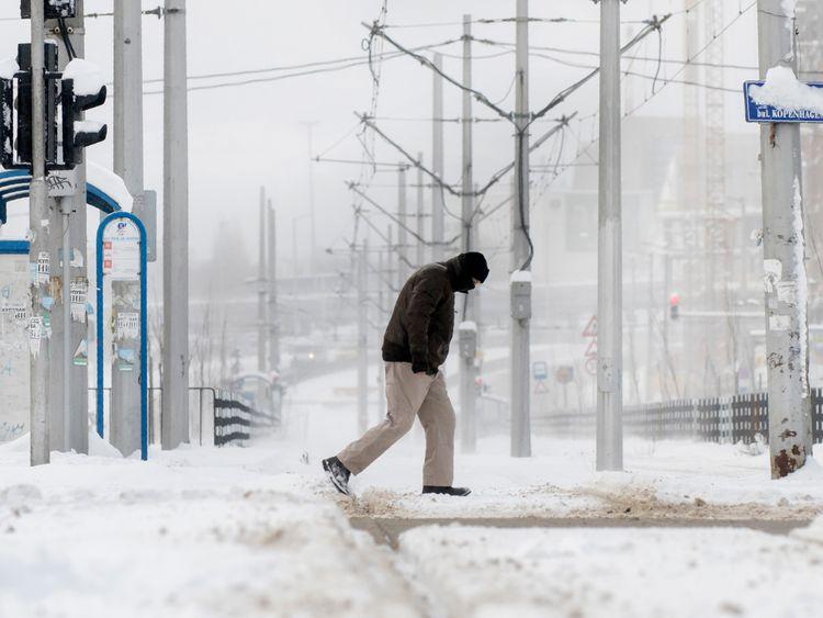 A man walks in a snowy suburb of Sofia, Bulgaria
