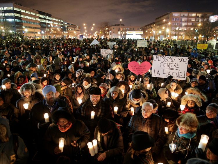 People attend a vigil in support of the Muslim community in Montreal, Quebec, January 30, 2017
