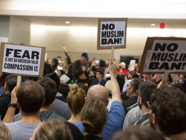 Protesters at Dallas-Forth Worth airport demonstrate against President Trump's travel ban order