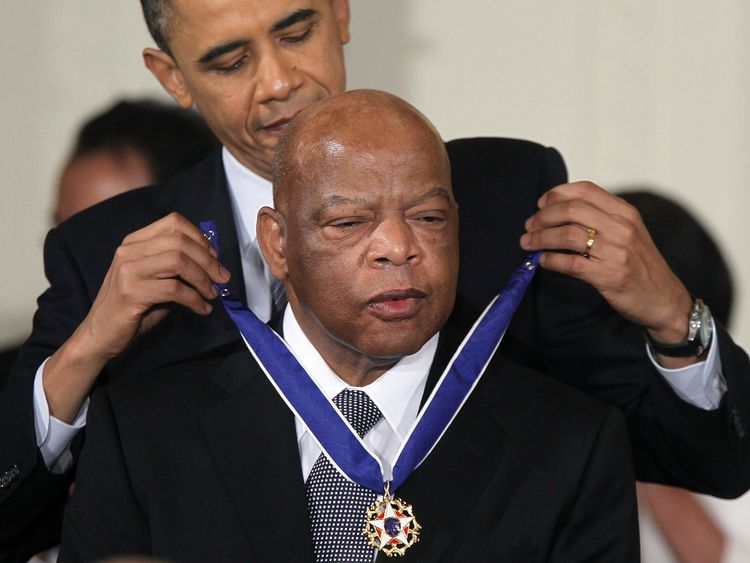 President Obama presents John Lewis with the Medal of Freedom, America's highest civilian honour, in 2010