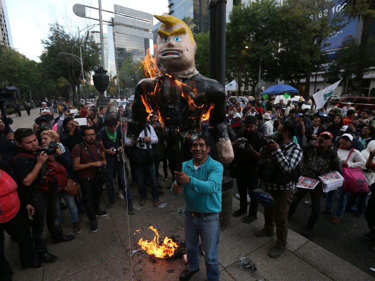Protesters burned a pinata of President Trump outside the US embassy