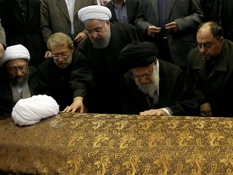 Iran's Supreme Leader Ayatollah Ali Khamenei and President Hassan Rouhani pay their respects