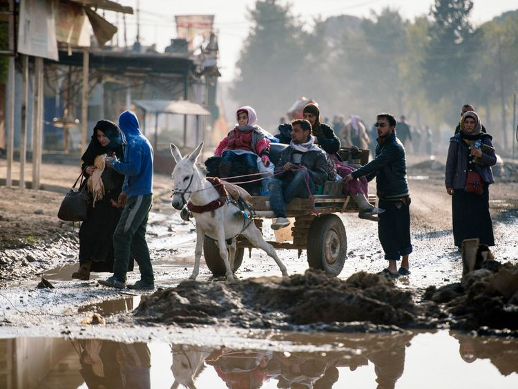 Iraqis ride a donkey-pulled-cart in Mosul's al-Zahraa neighbourhood on January 8, 2017, as they flee with other civilians during an ongoing military operation against Islamic State (IS) group militants. Elite Iraqi forces battling the Islamic State group in eastern Mosul reached the Tigris River that splits the city in two for the first time, a spokesman said