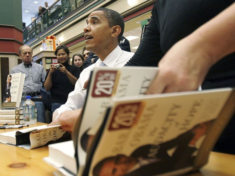 Barack Obama signs copies of his book The Audacity of Hope in 2006