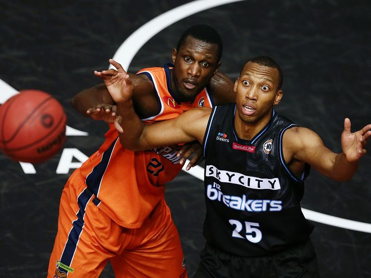 Akil Mitchell (R) of the Breakers looks to catch a pass against Nnanna Egwu of the Taipans
