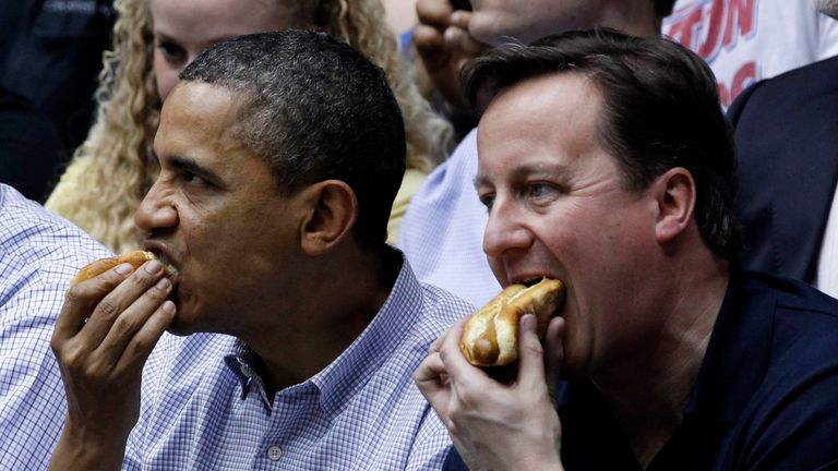 Barack Obama and David Cameron eat hot dogs at basketball game in Ohio, 2012