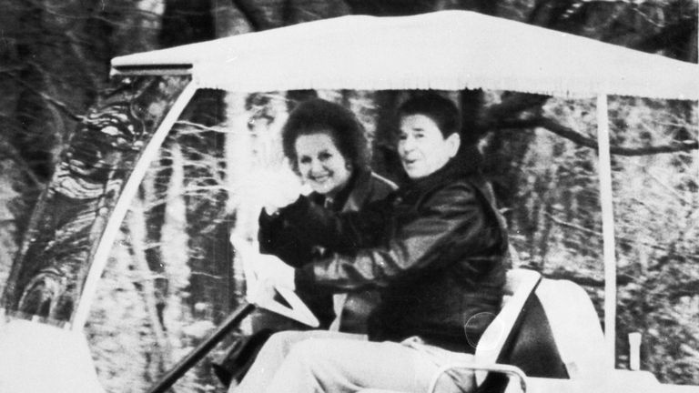 Ronald Reagan drives Margaret Thatcher toward their meeting in Camp David, 1986