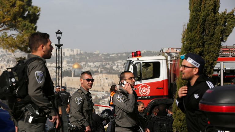 Security forces attend the scene of the attack