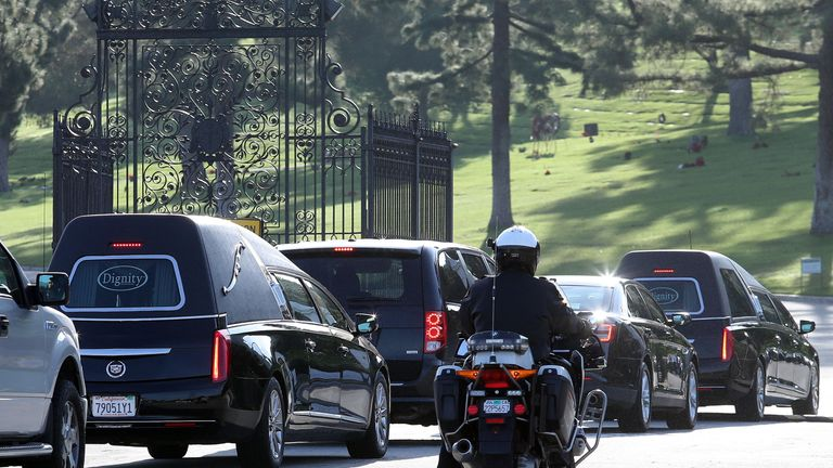 The funeral procession arrives at Forest Lawn Memorial Park