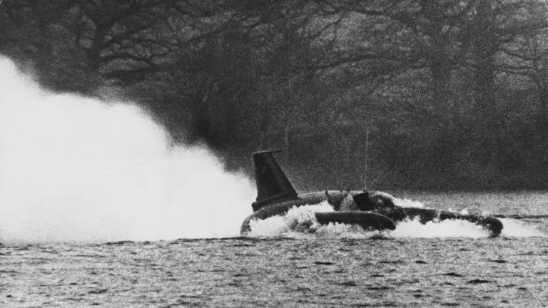 Donald Campbell in his 'Bluebird' at Coniston Water in Lancashire.