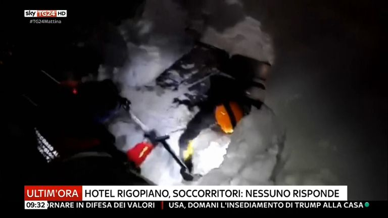 Rescuers dig through the snow to try to reach survivors