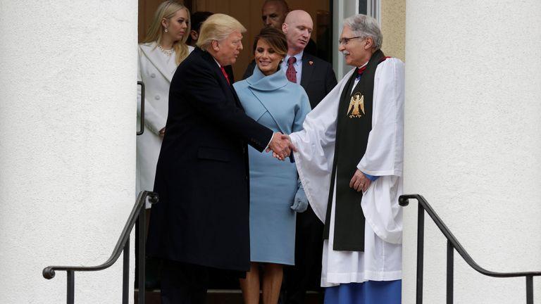 The Trumps greet Reverend Luis Leon at St. John's Church
