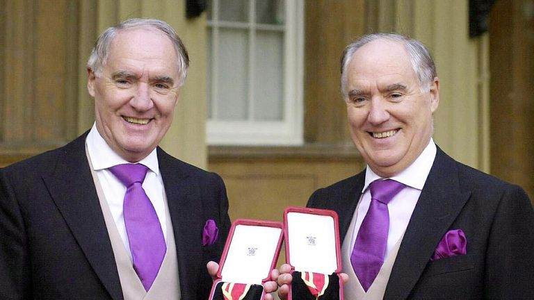 The Barclay brothers receiving their knighthoods in 2000