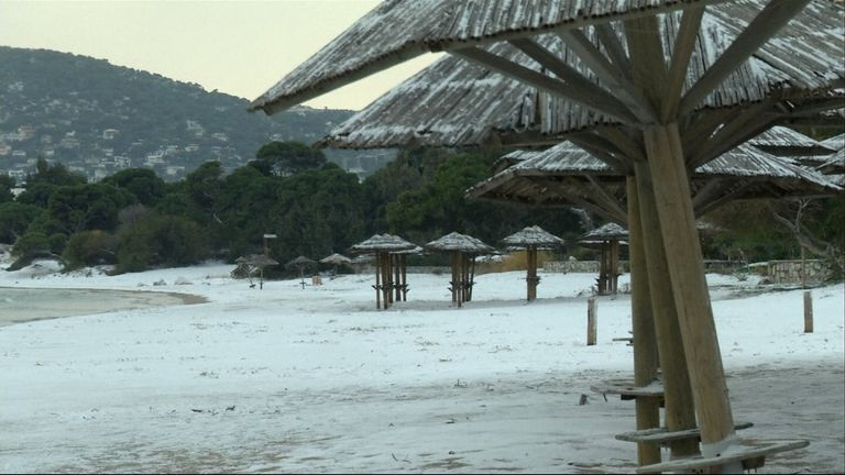 The beach at Artemida, Greece covered in snow