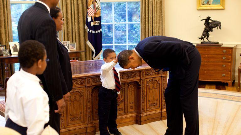Five-year-old Jacob Philadelphia touches Barack Obama's hair