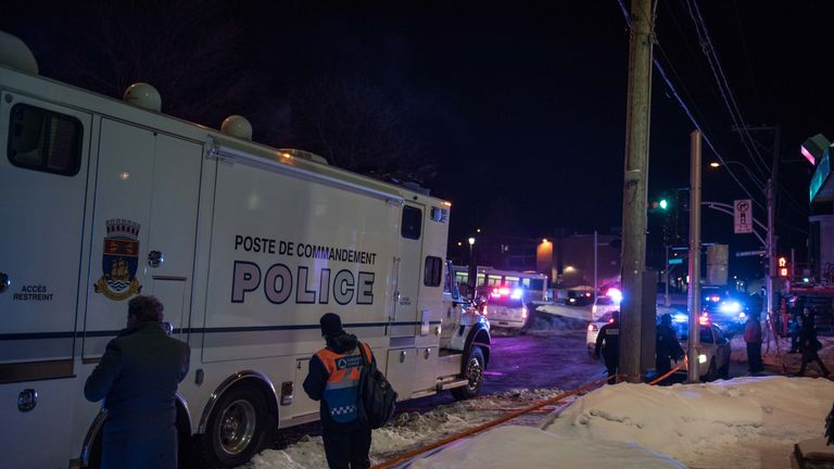 Canadian police officers respond to a shooting in a mosque at the Québec City Islamic cultural center on Sainte-Foy Street in Quebec city on January 29, 2017. Two arrests have been made after five people were reportedly shot dead in an attack on a mosque in Québec City, Canada. / AFP / Alice Chiche (Photo credit should read ALICE CHICHE/AFP/Getty Images)